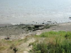 [Photo of Warden Point sound mirror remains]