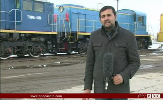 Screenshot of BBC Pashto video showing railway locomotives at Hairtatan in Afghanistan