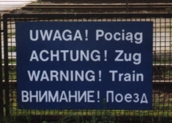 ['WARNING! Train' in Polish, German, English and Russian]