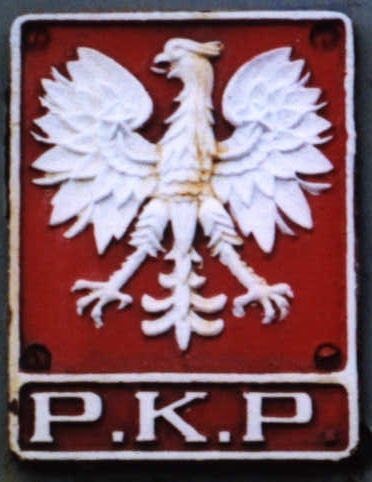 [Cast PKP emblem on a steam locomotive]